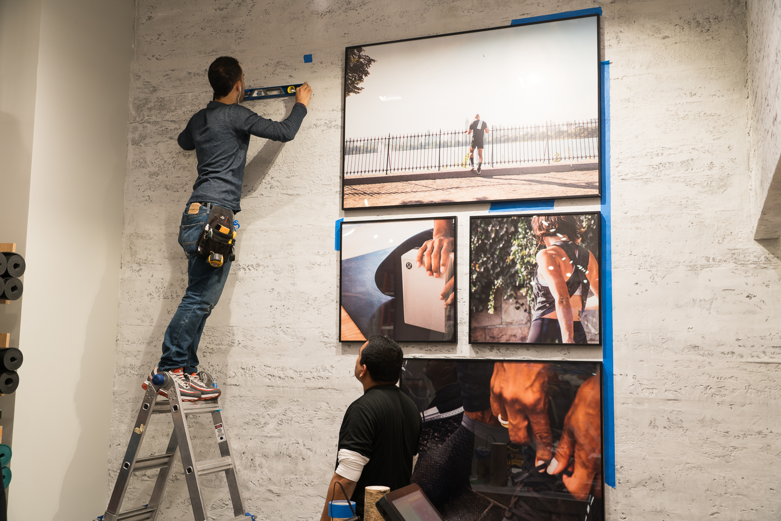 Installation of framed collage signage at lululemon